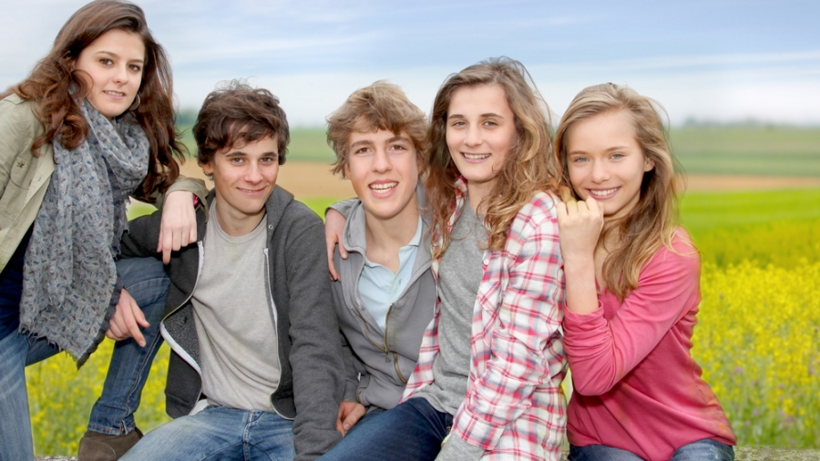 group-teenagers-sitting-outside