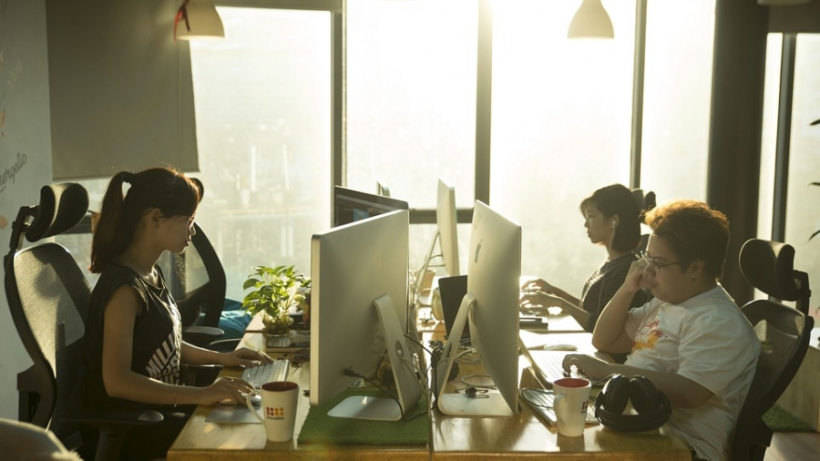 A modern company team in an open office environment.