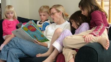 mother-reading-a-book-to-children-1438086-639x423